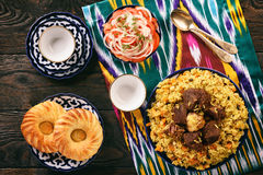 Pilaf- traditional asian dish, rice prepared with vegetables and meat. Oriental, uzbek style. stock images