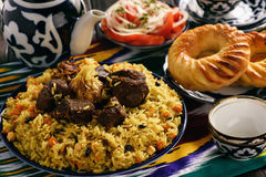 Pilaf- traditional asian dish, rice prepared with vegetables and meat. Oriental, uzbek style. royalty free stock images