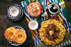 Pilaf- traditional asian dish, rice prepared with vegetables and meat. Oriental, uzbek style. royalty free stock photos