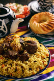 Pilaf- traditional asian dish, rice prepared with vegetables and meat. Oriental, uzbek style. royalty free stock image