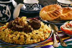 Pilaf- traditional asian dish, rice prepared with vegetables and meat. Oriental, uzbek style. stock photo