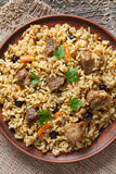 Pilaf is traditional delicious dish with fried Royalty Free Stock Image