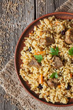 Pilaf traditional spicy asian food with rise, meat. Pilaf is traditional spicy asian food with rise, meat, onion, carrot and raisins. This dish is also called stock image