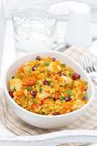Pilaf with vegetables, chicken and pomegranate in a bowl royalty free stock image