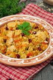Pilaf with vegetables, chicken and pomegranate on a plate stock images