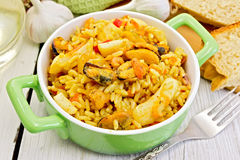 Free Pilaf With Seafood And Fork On Board Royalty Free Stock Image - 50115536