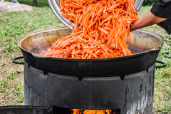 Pilaff - adding chopped carrots over mutton Royalty Free Stock Image
