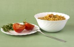 Pilaff och tomater Fotografering för Bildbyråer