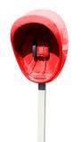 Pilar con el aparato de teléfono rojo de la calle aislado Imagen de archivo libre de regalías