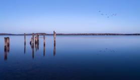 Pilares para una litera en el mar Báltico Imagen de archivo libre de regalías