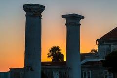 Pilares viejos en la puesta del sol Imágenes de archivo libres de regalías