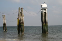 Pilars in the sea. Pilars with transmission facilities in the Norden Sea Stock Photos