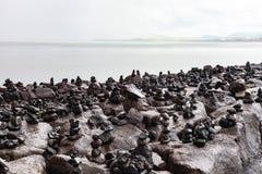 Pilas construidas turista de rocas en Reykjavik foto de archivo