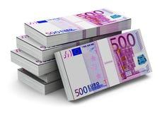 Pilas de 500 billetes de banco euro Foto de archivo libre de regalías