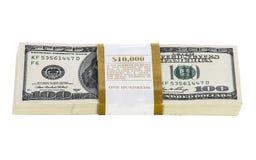 Pilas de 100 billetes de dólar aislados en blanco Fotos de archivo libres de regalías