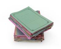 Pilas de carpetas coloridas Imagenes de archivo