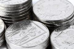 Pilas de diez monedas de los peniques Imágenes de archivo libres de regalías