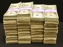 Pilas de dinero Imagen de archivo libre de regalías