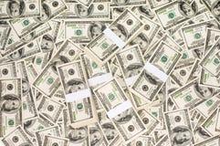 Pilas de dinero Imágenes de archivo libres de regalías
