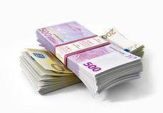 Pilas de dinero de los euros Imágenes de archivo libres de regalías
