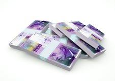 Pilas de dinero de Suiza aisladas en el fondo blanco Foto de archivo