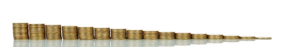 Pilas de disminución o cada vez mayores de las monedas Imagen de archivo