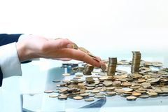 Pilas de las monedas Fotos de archivo libres de regalías