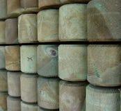 Pilas de madera impregnadas Foto de archivo libre de regalías