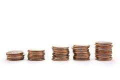 Pilas de monedas de diez centavos Imagen de archivo