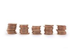 Pilas de monedas de diez centavos Imagenes de archivo
