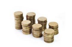 Pilas de monedas de oro Foto de archivo libre de regalías