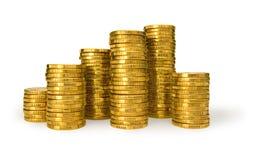 Pilas de monedas de oro Imágenes de archivo libres de regalías