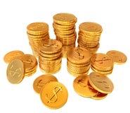 Pilas de monedas del dólar del oro Foto de archivo libre de regalías