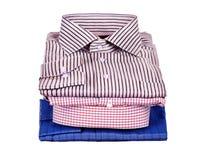 Pilas de mucha ropa coloreada Imagen de archivo libre de regalías