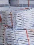 Pilas de papel en una imprenta Imágenes de archivo libres de regalías