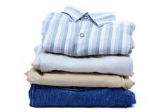 Pilas de ropa coloreada de hombres Fotografía de archivo libre de regalías
