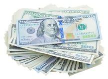 Pilas de Thre de dinero de los dólares Fotos de archivo