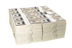 Pilas de un millón dólares de EE. UU. en cientos billetes de banco del dólar Imagen de archivo libre de regalías