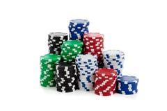Pilas de virutas de póker en blanco Imágenes de archivo libres de regalías