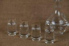 Pilas de vodka en un fondo marrón Fotos de archivo libres de regalías