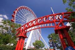 Pilastro del blu marino e la rotella di Ferris Fotografia Stock Libera da Diritti