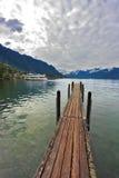Pilastro di legno della barca sul lago Lemano Fotografia Stock