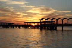 Pilastro di pesca al tramonto Immagine Stock