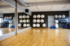 Pilate Balls Arranged In Shelves By Mirror. At gym Stock Photos