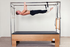 Pilates aerobic instructor man in cadillac fitness Royalty Free Stock Images