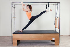 Pilates aerobic instructor woman in cadillac Royalty Free Stock Photos