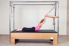 Pilates aerobic instructor woman in cadillac Royalty Free Stock Images