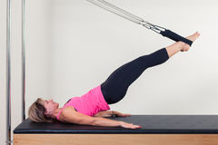 Pilates aerobic instructor woman in cadillac Royalty Free Stock Image