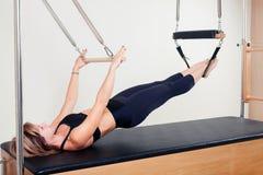 Pilates aerobic instructor woman in cadillac Royalty Free Stock Photos