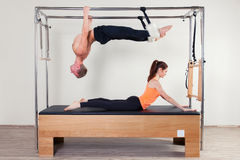 Pilates aerobic instructor woman and man in Stock Images